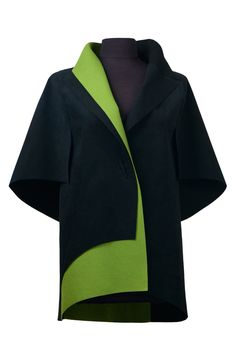 Ambassador Jacket by Teresa Maria Widuch . Superbly crafted in a combination of soft yet resilient Ultrasuede and felted merino wool, this striking asymmetrical design is a bold yet versatile statement piece. The artist's unique open sleeve design is open on bottom, providing both coverage and freedom of movement.