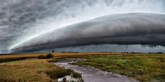 Rural Shelf (thunderstorm clouds water ). Photo by Zeman88  Uploaded by: Zeman88 Friday September 9, 2016 Rolfe, IA (Current Weather Conditions) Caption: A large shelf cloud slowly approaches over a swollen creek in rural northwest Iowa. Camera Type: NIKON D3300