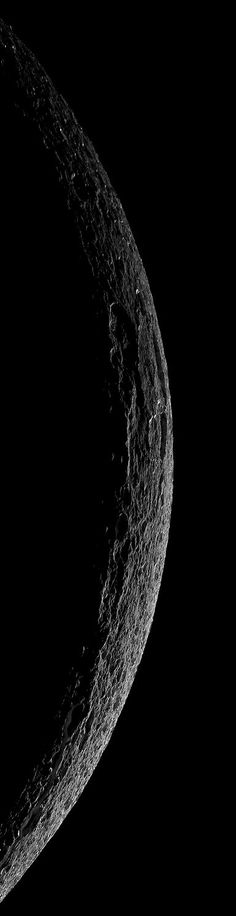 Crescent Dione from Cassini, October 11, 2005 ~ Thin crescent of cratered terrain is illuminated on Saturn's fourth largest moon, Dione. As it departed its encounter with Saturn's moon Dione, Cassini sailed above an unreal landscape blasted by impacts. The rising Sun throws craters into sharp contrast and reveals steep crater walls.The Cassini-Huygens mission is a cooperative project of NASA, the European Space Agency and the Italian Space Agency