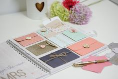 Create a wedding guest book with a difference by using a selection of cardstock, a handful of embellishments and a glue gun. This envelope guestbook may look complicated but it's incredibly easy to create, meaning you can have your guest book ticked off your to-do list in next to no time at all.