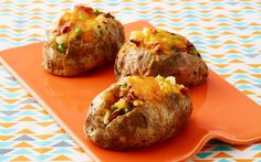 Twice-Baked Cheddar Potatoes ~ You'll need:  4 large russet potatoes, scrubbed, 3 T olive oil, 1¼ C grated cheddar cheese, divided, 1 C assorted mix-ins (see below), Kosher salt & freshly ground pepper. Stuff your potatoes with 1 cup of one or more of these fillings: Steamed broccoli, Sautéed spinach, Steamed peas, Shredded rotisserie chicken, Cooked shrimp, Canned chili, Chopped white onion, Chopped, sun-dried tomatoes, Chopped scallions, Diced ham, Salsa, Diced tomatoes or Guacamole.