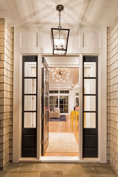 The front entry lighting is a medium Darlana Lantern from Circa Lighting.