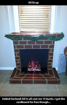 Fireplace in my apt!!!  Cardboard temporary fireplace for Christmas mantle decor  $15 project!!!