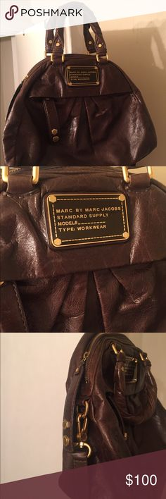 MARC by Marc Jacobs Purse Gently used brown leather satchel style bag. Patterned inside. Shows some slight signs of wear. Plenty of use left with this bag! Comes with dust bag for storage! Also comes with long strap to wear across body or shoulder. Marc By Marc Jacobs Bags Satchels