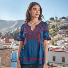 """FABLE EMBROIDERED TOP--Tell your story with our folklore-embroidered, short-sleeve top. Shirring on sides for a flattering, easy fit. Split neckline. Rayon. Machine wash. Imported. Exclusive. Sizes XS (2), S (4 to 6), M (8 to 10), L (12 to 14), XL (16). Approx. 26""""L."""