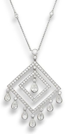 A diamond pendant necklace, by Tiffany & Co.  Composed of a double square frame of brilliant-cut diamonds, spaced by a similarly-cut diamond, suspending brilliant-cut and pear-shaped diamonds, to a trace-link chain interspersed with brilliant-cut collet-set diamonds, mounted in platinum, the diamonds estimated to weigh approximately 3.69 carats in total, signed 'Tiffany & Co.', necklace length 41.5cm, pendant length 5.5cm