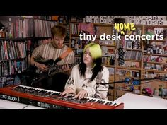 "What looks just like NPR's intimate ""Tiny Desk Concert"" setting is actually a cardboard cutout. But that is the real Bille Eilish and her brother Finneas. Billie Eilish, Tiny Desk, New Music, Good Music, Stephen Thompson, Audio Mastering, James Bond Theme, Music Clips, National Convention"
