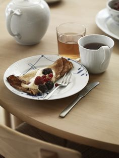Scandinavian design, Blue Fluted Mega plate and White Fluted mug and teapot.