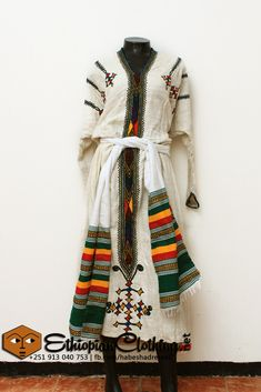 Handspun and handwoven organic Ethiopian cotton with traditional Gondar style hand embroidery.