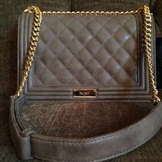 """BCBG Purse Taupe BCBG shoulder bag with a 22"""" strap with chain plus another strap with purse material and magnetic close.  Has 3 inside pockets one with a zipper. Comes with dust bag. NWT. BCBG Bags Shoulder Bags"""