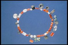 Carnelian and rock crystal beads with silver amulets. Birka BJ632