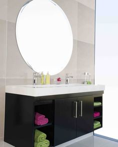 An over-sized basin is ideal for a family bathroom, consider one that allows for two taps to be fitted Interior Decorating, Interior, Bathroom Basin, Bathroom Mirror, Round Mirror Bathroom, Colorful Towel, Bathroom Design, Beautiful Bathrooms, House Colors