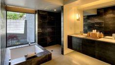 [B4] bath with floating vanity, using same tiles as on walls, tub on vanity itself