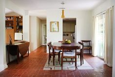 love the table and chairs, the painting, the light, the floors, the drop-side table, the view of other rooms