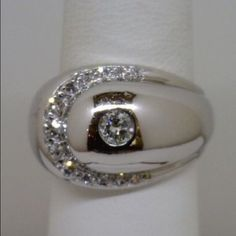 14K White Gold Diamond Statement Ring Not for the faint of heart! This is a gorgeous and LARGE ring. Quality diamonds with a total of .40cwt set in solid 14k (Hallmarked inside band) white gold. High polish finish. Like new! Approximately 14mm wide and weighs over 9 grams! SIZE 5.75 - 6 and easily sized by your jeweler. Jewelry Rings