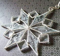 This stained glass snowflake is made from glue chip glass (resembles frost) and bevels. I use lead free solder on these items. A lovely Stained Glass Ornaments, Stained Glass Christmas, Stained Glass Suncatchers, Stained Glass Lamps, Stained Glass Designs, Stained Glass Panels, Stained Glass Projects, Stained Glass Patterns, Mosaic Glass