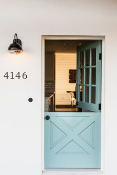 Light blue Dutch door perfection. Definitely want a Dutch door back door