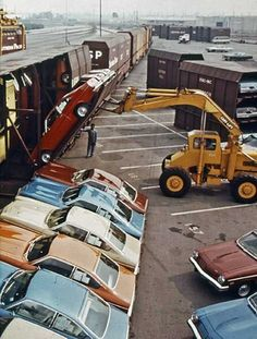 1974, Chevrolet Vega being transported via train carriers.