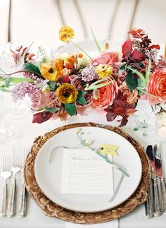 Colorful and modern wedding reception place setting. Flowers by Sarah Winward.