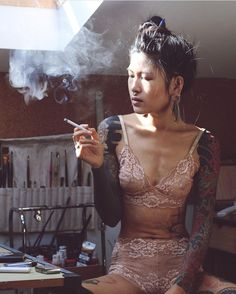 Anh Wisle Black Sleeve Tattoos. Lotus tattoo. Smoking cigarette in pink lingerie.