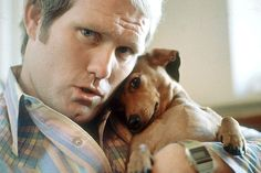 indypendent-thinking:  Pittsburgh Steelers quarterback Terry Bradshaw poses with his dachshund puppy, Rowdy, at his home in December 1978. Photo by Bill Eppridge