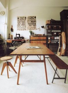 Vintage industrial is a great style for a craft room or work room. A long table is a must for bigger projects, or cutting fabric.