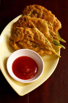 spinach fritters or palak pakoras – crisp fritters made with whole spinach leaf and spiced gram flour batter.