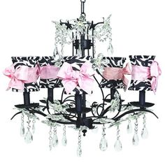 my daughter wants this...yep.  Zebra lamp shades on a 6 arm chandelier with dangling crystals and pink bows found at www.thepinkstore.com