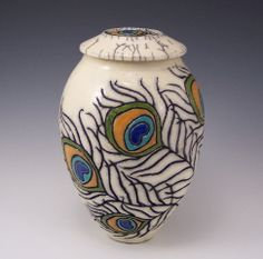 """Wheel thrown Jar with incised stylized free-form Peacock feather motif, Raku fired. Inspired the aesthetic and spirit of art nouveau design.  Approximately 8"""" H x 5.5"""" W and is signed and dated  Anne Webb"""