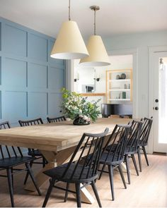 modern farmhouse Dining room with blue paneled walls and long farmhouse rustic dining room table and black windsor chairs with modern pendants in dining room decor, Love the black dining chairs too Dining Room Blue, Black Dining Chairs, Dining Room Walls, Dining Room Design, Light Wood Dining Table, Colored Dining Chairs, White Chairs, Wood Table, Dining Tables