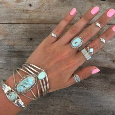 http://www.childofwild.com/collections/shop/products/blue-seaing-opal-zuni-ring