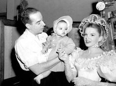 "Director Vincente Minnelli (left) worked in various capacities with wife Judy Garland (right) on seven films including ""Meet Me in St. Louis"" and ""The Pirate"" they are pictured here on the set of the latter with their infant daughter, Liza Minnelli. Old Hollywood Glamour, Golden Age Of Hollywood, Vintage Hollywood, Hollywood Stars, Classic Hollywood, Hollywood Icons, Hollywood Couples, Judy Garland Liza Minnelli, Rita Moreno"