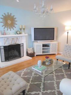 "Cute living room. I love the ""love"" sign on the fire place!"