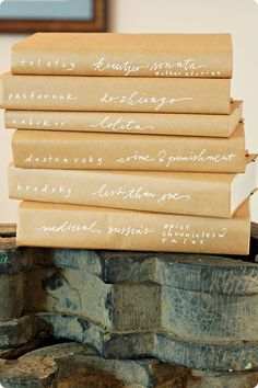 genius. and gorgeous. simple way to cover books. i might be doing this to all my textbooks from grad school...