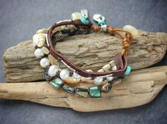 Mixed media, pearl, abalone and leather multistrand bracelet by Luna's @ www.ShopLunasLoft.com #artisan #jewelry #handmade #boho #shabbychic #pearl #handcrafted #beachy