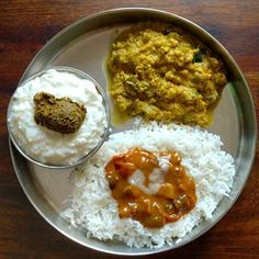Lunch on my plate has... . - Steamed Rice - Kathirikkai Puli Kulambu - A dash of homemade ghee - Zucchini Poricha Kootu - Pazhaya Sadam mixed with Curd - Pudina Thogayal . Bought Zucchini for a salad but it tasted a bit bitter, so used it in kootu instead. . . . . #ticklingpalates #southindianfood #indiancuisine #indianfood #vegetarian #glutenfree South Indian Breakfast Recipes, Indian Food Recipes, Ethnic Recipes, South Indian Food, Steamed Rice, Bitter, Glutenfree, Zucchini, Curry