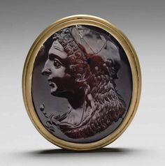 Carnelian intaglio. 2nd–1st century B.C. Set in modern gold setting. Head of Herakles, wearing lion skin tied around his neck Length: 43 mm .