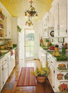 Vintage Cottage Style Interiors So much I like in such a small kitchen: counters, wood floor and the ceiling, to name a few.So much I like in such a small kitchen: counters, wood floor and the ceiling, to name a few. New Kitchen, Vintage Kitchen, Kitchen Dining, Kitchen Counters, Kitchen Ideas, Kitchen Yellow, Tile Counters, Kitchen Walls, Kitchen Soffit