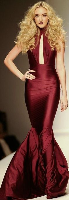 Michael Costello created a hobble skirt for one of his collections. The hobble skirt, created by Paul Poiret, let women get rid of the corset. However, the skirt was still a garment that restricted movement for women. Style Haute Couture, Couture Fashion, Runway Fashion, Fashion Trends, Red Fashion, High Fashion, Fall Fashion, Burgundy Gown, Schneider