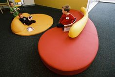 Designed with varying seat depths for adults and kids to share storytime comfortably Commercial Interior Design, Commercial Interiors, Custom Sofa, Library Design, Floor Mats, Furniture Design, Objects, Flooring, Kids