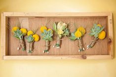 a rustic unit for exposıng flowers on wall