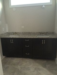 Timberlake Sonoma espresso cabinets and moonlight granite. Sherwin Williams  agreeable gray paint on the walls.