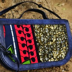 Hand dyed #blue #leather bag with a beautiful #AfricanWax print material. Can be worn as a #clutch or #crossbody #handbag. #Handmade in #Senegal.