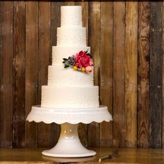 Five-tier white and pink champagne wedding cake | Tasha Owen/Photographer | Theknot.com