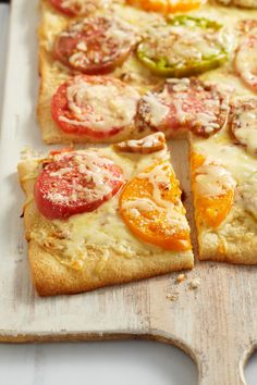 Heirloom Pizza Margherita -- Fresh heirloom tomatoes give this pizza recipe its beautiful color--and using a refrigerated pizza crust makes this Margherita pie a quick weeknight dish that's ready in under 30 minutes.