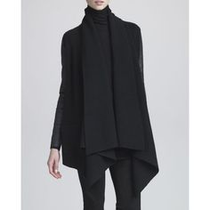 Donna Karan LeatherSleeve Rib-Knit Sweater ML NWT Donna Karan Leather-Sleeve Rib-Knit Sweater.  A masterful mix of textures, this Donna Karan cardigan features a wool/cashmere ribbed knit and sleek leather sleeves.  Ribbed knit with leather.  Open cascading front.  Draped shoulders.  Long leather sleeves.  Relaxed silhouette.  Dipped front hem; hits past seat.  Merino wool/cashmere.  M/L NWT Donna Karan  Jackets & Coats
