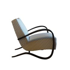 20th Century Beechwood Pair of Lounge Chairs   From a unique collection of antique and modern lounge chairs at https://www.1stdibs.com/furniture/seating/lounge-chairs/