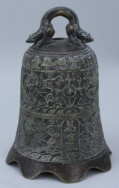 "An unusual Chinese bronze bell cast with thel Xuande mark. The Xuande Emperor (Chinese: 宣德帝), 16 March 1399 – 31 January 1435), was the 5th emperor of the Ming Dynasty of China from 1426 to 1435. His era name means ""Proclamation of Virtue""."