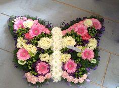 Funeral Flowers. pink butterfly funeral flower tribute, bespoke funeral flowers, unusual funeral flowers www.thefloralartstudio.co.uk