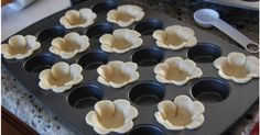 Love this: Cut pie or tart crust dough into flower shapes, bake in a mini cupcake pan, and fill with your favourite filling. Sugar cookie do...
